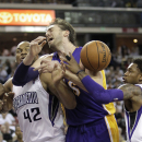 Los Angeles Lakers center Pau Gasol,center, of Spain, battles Sacramento Kings' Chuck Hayes, left, and Ben McLemore for the ball during during the third quarter of an NBA basketball game in Sacramento, Calif., Friday, Dec. 6, 2013. The Lakers won 106-