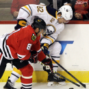 Buffalo Sabres left wing Marcus Foligno (82) and Chicago Blackhawks right wing Marian Hossa (81) battle for the puck during the first period of an NHL hockey game in Chicago, Saturday, Oct. 11, 2014 The Associated Press