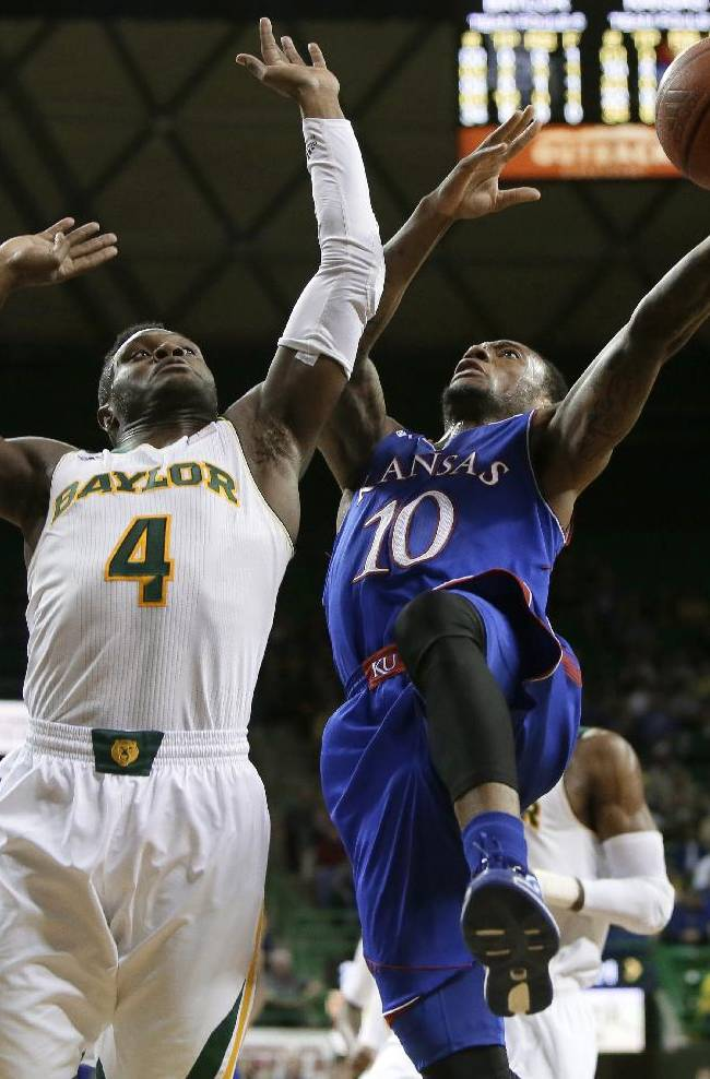 Baylor guard Gary Franklin (4) defends against a shot by Kansas' Naadir Tharpe (10) in the first half of an NCAA college basketball game, Tuesday, Feb. 4, 2014, in Waco, Texas