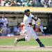 OAKLAND, CA - MAY 19: Yoenis Cespedes #52 of the Oakland Athletics hits a home run off of Kelvin Herrera (not pictured) of the Kansas City Royals during the eighth inning at O.co Coliseum on May 19, 2013 in Oakland, California. The Oakland Athletics defeated the Kansas City Royals 4-3. (Photo by Jason O. Watson/Getty Images)