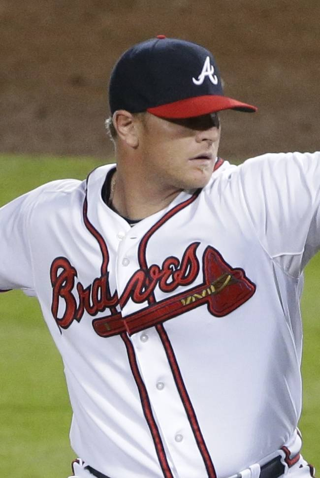 Atlanta Braves relief pitcher David Carpenter works against the Los Angeles Dodgers in the eighth inning of Game 1 of the National League Divisional Series, Thursday, Oct. 3, 2013, in Atlanta