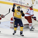 Nashville Predators center Mike Fisher (12) celebrates after scoring the tying goal in the third period of an NHL hockey game against the Carolina Hurricanes Tuesday, Jan. 6, 2015, in Nashville, Tenn The Associated Press