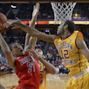 FILE - In this Jan. 12, 2014, file photo, Arizona forward Brandon Ashley, left, puts up a shot as Southern California center Omar Oraby, center, and guard Julian Jacobs defend during the second half of an NCAA college basketball game in Los Angeles. Arizona lost two key contributors from that team: Guard and leader Nick Johnson, and athletic freshman forward Aaron Gordon. And yet, the Wildcats are considered on the short list of favorites to win this season's national title. (AP Photo/Mark J. Terrill, File)