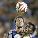 Real Salt Lake defender Abdoulie Mansally, right, battles for the ball against San Jose Earthquakes midfielder Jean-Baptiste Pierazzi during the second half of an MLS soccer match Saturday, Aug. 30, 2014, in Santa Clara, Calif. The game ended in a 1-1 tie