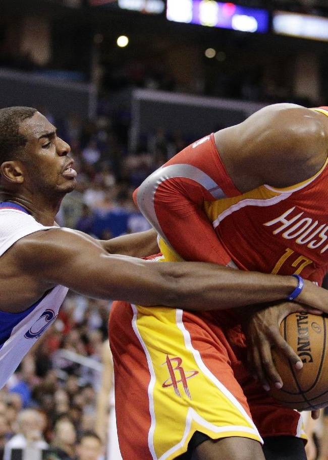 Houston Rockets' Dwight Howard, right, is fouled by Los Angeles Clippers' Chris Paul during the second half of an NBA basketball game on Monday, Nov. 4, 2013, in Los Angeles