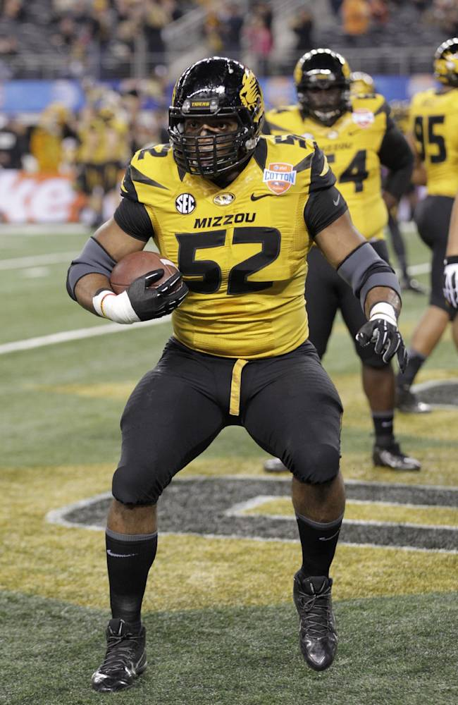 Missouri defensive lineman Michael Sam (52) warms up before the Cotton Bowl NCAA college football game against Oklahoma State, Friday, Jan. 3, 2014, in Arlington, Texas