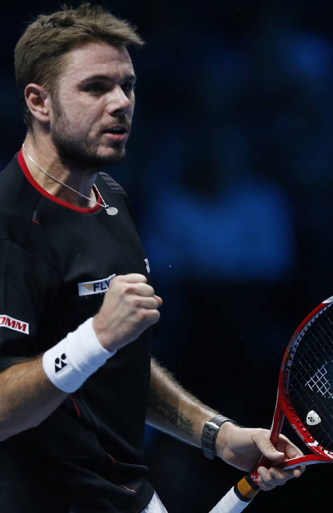 Stanislas Wawrinka of Switzerland pumps his fist after winning a point against Tomas Berdych of Czech Republic during their ATP World Tour Finals single tennis match at the O2 Arena in London Monday, Nov. 4, 2013
