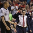 Arizona coach Sean Miller, right, reacts after being called for a technical foul in the second half against UCLA during a semifinal Pac-12 tournament NCAA college basketball game, Friday, March 15, 2013, in Las Vegas. UCLA won 66-64. (AP Photo/Julie Jacobson)
