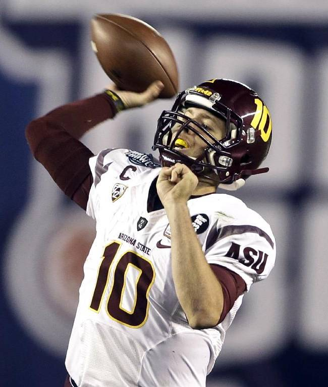 Arizona State quarterback Taylor Kelly fires a pass against Texas Tech during the first half of the Holiday Bowl NCAA college football game, Monday, Dec. 30, 2013, in San Diego. Kelly was held to 14 yards passing in the first half