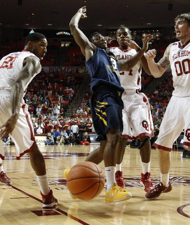 Clark leads No. 23 Oklahoma past West Virginia