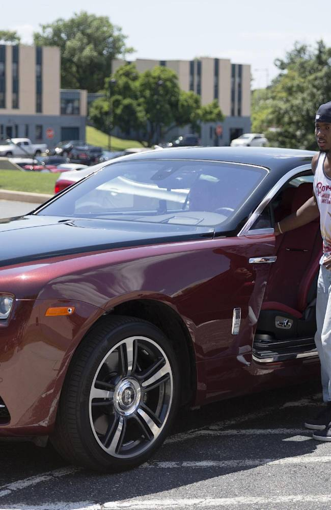 Philadelphia Eagles running back LeSean McCoy gets into his car and leaves NFL football training camp, Friday, July 25, 2014, in Philadelphia. (AP Photo)