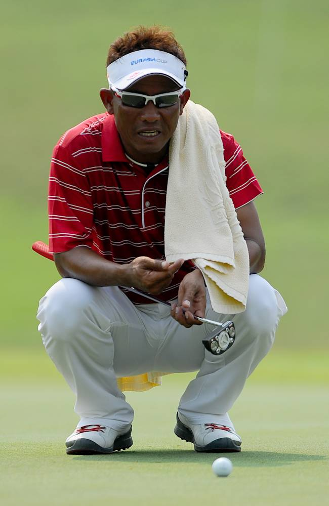 Thailand's Thongchai Jaidee lines up a putt on the sixth hole during the second round of the EurAsia Cup golf tournament at the Glenmarie Golf and Country Club in Subang, Malaysia Friday, March 28, 2014