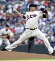 Minnesota Twins pitcher Kevin Correia throws against the Cleveland Indians in the first inning of a baseball game, Saturday, July 20, 2013, in Minneapolis. (AP Photo/Jim Mone)