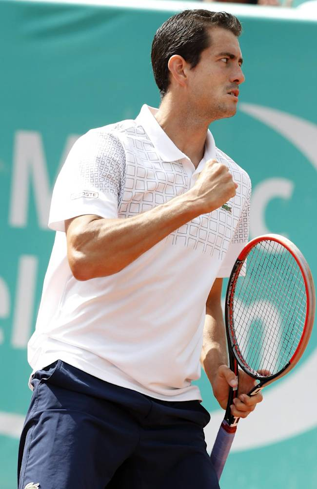 Guillermo Garcia-Lopez of Spain celebrates a point after serving against Spain's Marcel Granollers, in the final of the Grand Prix Hassan II tennis tournament in Casablanca, Morocco, Sunday, April 13, 2014. Guillermo Garcia-Lopez defeated Spain's Marcel Granollers 5-7, 6-4. 6-3