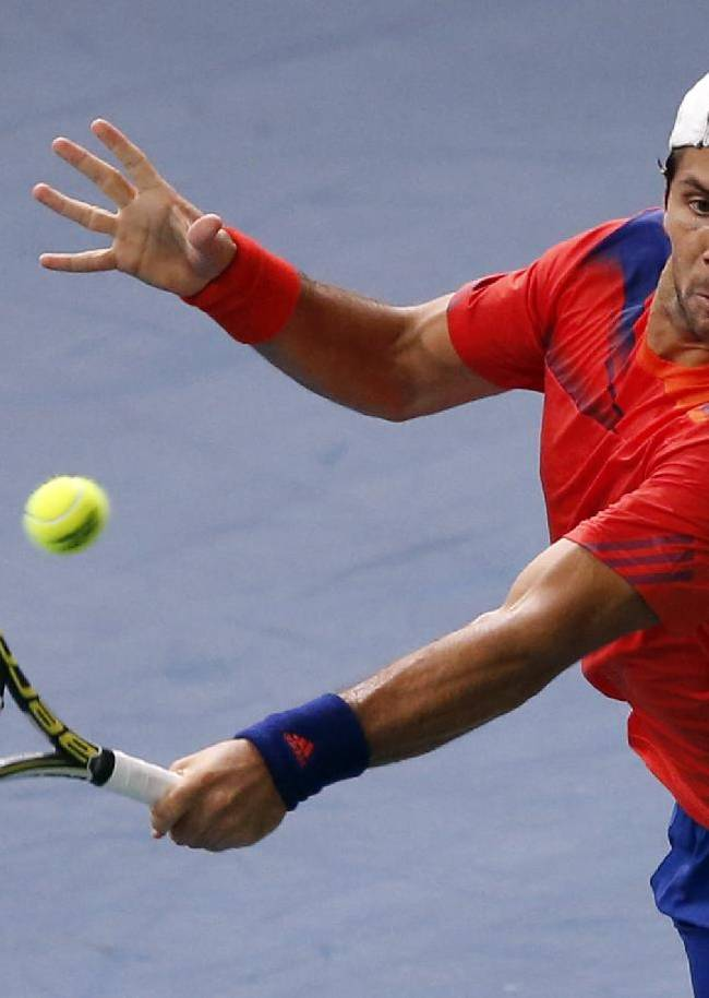 Fernando Verdasco of Spain returns the ball to Ernests Gulbis of Latvia during the first round of the BNP Masters indoor tennis tournament at Bercy Arena in Paris, France, Monday, Oct. 28, 2013