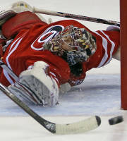 Carolina Hurricanes goalie Justin Peters (35) eyes the puck as a teammate clears during the first period of an NHL hockey game against the Colorado Avalanche in Raleigh, N.C., Tuesday, Nov. 12, 2013. (AP Photo/Karl B DeBlaker)