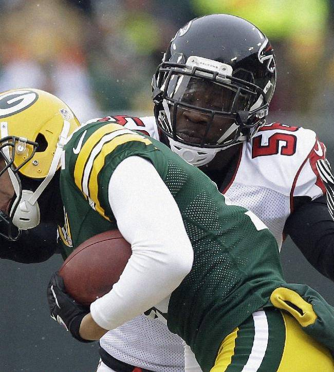 Green Bay Packers' Myles White catches a pass in front of Atlanta Falcons' Sean Weatherspoon during the second half of an NFL football game Sunday, Dec. 8, 2013, in Green Bay, Wis