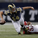 St. Louis Rams quarterback Shaun Hill (14) throws an incomplete pass as he is tackled by Arizona Cardinals outside linebacker Alex Okafor (57) during the first half of an NFL football game Thursday, Dec. 11, 2014 in St. Louis The Associated Press
