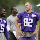Minnesota Vikings tight end Kyle Rudolph (82) talks with wide receiver Greg Jennings (15) during NFL football training camp, Monday, July 28, 2014, in Mankato, Minn The Associated Press