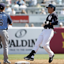 New York Yankees center fielder Jacoby Ellsbury, right, pulls into second on a double as Tampa Bay Rays shortstop Jayson Nix (16) stands near during a spring training baseball game in Tampa, Fla., Sunday, March 9, 2014. The game ended in a 3-3 tie The Ass