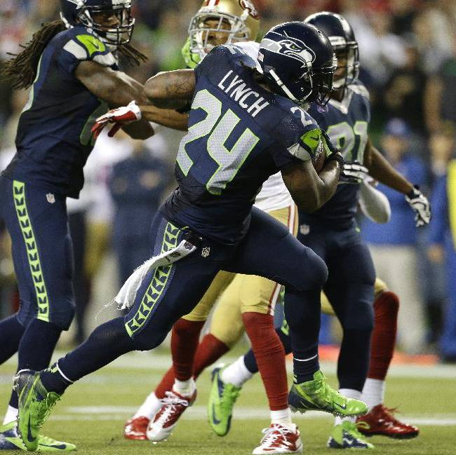 Seattle Seahawks running back Marshawn Lynch (24) runs for a touchdown against the San Francisco 49ers in the second half of an NFL football game, Sunday, Sept. 15, 2013, in Seattle