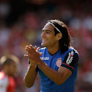 Man United signs Falcao loan with option to buy (The Associated Press)