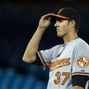 Baltimore Orioles starting pitcher Kevin Gausman looks on after allowing Toronto Blue Jays' J.P. Arencibia to hit a two-run home run during fifth-inning baseball game action in Toronto, Thursday, May 23, 2013.  (AP Photo/The Canadian Press, Nathan Denette)