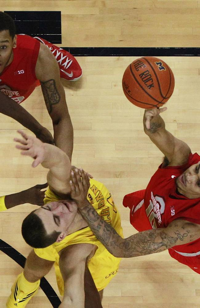 In this Feb. 5, 2013 file photo, Ohio State forward LaQuinton Ross, right, shoots over Michigan forward Mitch McGary, as Michigan guard Tim Hardaway Jr., left, and Ohio State center Amir Williams, top, watch during the second half of an NCAA college basketball game in Ann Arbor, Mich. With the departure of Deshaun Thomas, who averaged 19.8 points a game a year ago, Ross must step into the spot as the Buckeyes' designated point-producer this season
