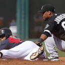 Cleveland Indians' Carlos Santana slides safely into second base under the tag of Chicago White Sox second baseman Micah Johnson during an exhibition baseball game in Goodyear, Ariz., Tuesday, March 4, 2014 The Associated Press