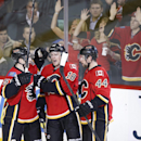 Calgary Flames' Matt Stajan, center, celebrates his goal against the Los Angeles Kings with Kenny Agostino, left, and Chris Butler during the second period of an NHL hockey game in Calgary, Alberta, Wednesday, April 9, 2014 The Associated Press