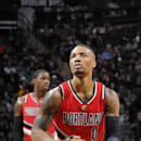 SAN ANTONIO, TX - DECEMBER 19: Damian Lillard #0 of the Portland Trail Blazers prepares to shoot against the San Antonio Spurs during the game on December 19, 2014 at AT&T Center in San Antonio, TX. (Photo by D. Clarke Evans/NBAE via Getty Images)