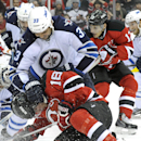 Winnipeg Jets' Dustin Byfuglien (33) checks New Jersey Devils' Steve Bernier (18) during the second period of an NHL hockey game Monday, Nov. 25, 2013, in Newark, N.J The Associated Press
