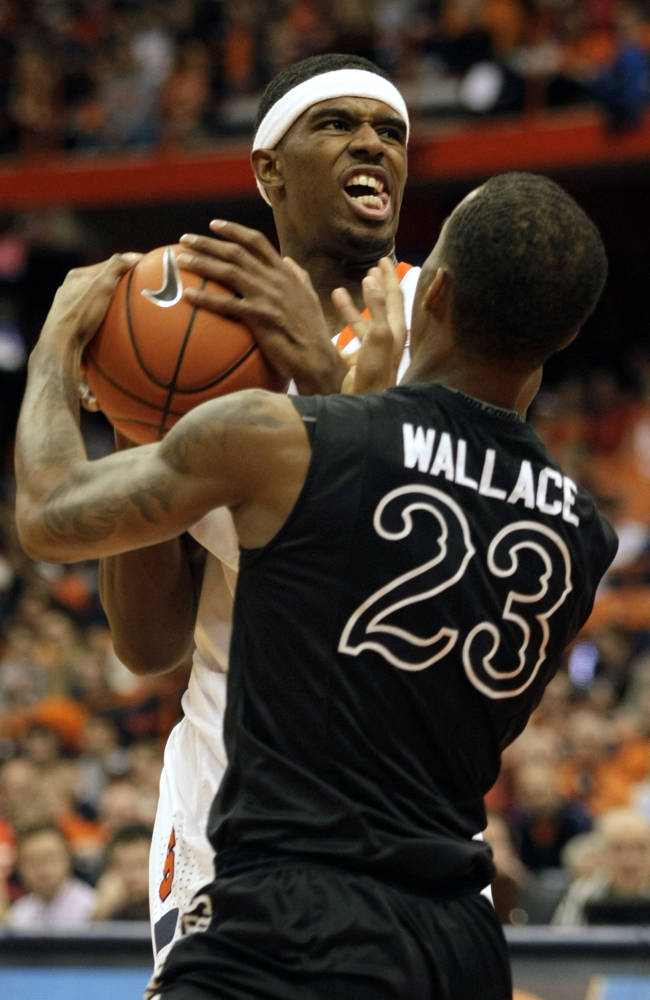 Syracuse's C.J. Fair, left, battles for the ball against High Point's Devante Wallace, right, in the first half of an NCAA college basketball game in Syracuse, N.Y., Friday, Dec. 20, 2013