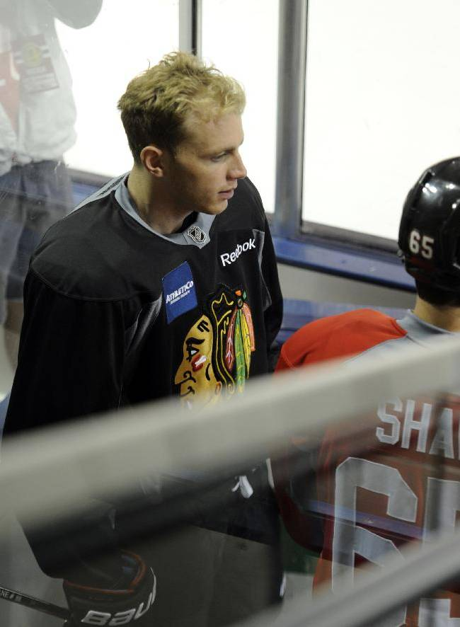 Chicago Blackhawks' Patrick Kane gets ready to take the ice at the teams NHL hockey training camp on the campus of the University of Notre Dame in South Bend, Ind., Thursday, Sept. 12, 2013