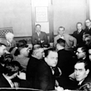 In this 1921 file photo, Judge Kenesaw Mountain Landis, rear left, inquires players of the Chicago White Sox, during the investigation of the infamous
