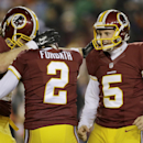 Washington Redskins' Kai Forbath (2) is congratulated by tight end Logan Paulsen (82) and punter Tress Way (5) after kicking the winning field goal in an NFL football game in Landover, Md., Saturday, Dec. 20, 2014. The Redskins defeated the Philadelphia Eagles 27-24. (AP Photo/Patrick Semansky)