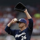 Milwaukee Brewers starting pitcher Kyle Lohse stands on the mound after giving up an RBI-single to St. Louis Cardinals' David Freese during the fourth inning of a baseball game on Sunday, May 19, 2013, in St. Louis. (AP Photo/Jeff Roberson)
