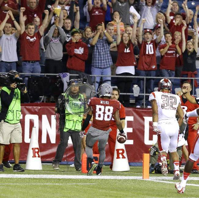 Fans cheer as Washington State wide receiver Isiah Myers (88) scores a touchdown against Rutgers in the first half of an NCAA college football game, Thursday, Aug. 28, 2014, in Seattle