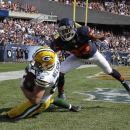 Green Bay Packers wide receiver Jordy Nelson (87) makes a touchdown reception against Chicago Bears cornerback Kyle Fuller (23) in the first half of an NFL football game Sunday, Sept. 28, 2014, in Chicago. The Associated Press