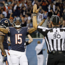 FILE - In this Aug. 14, 2014, file photo, Chicago Bears wide receiver Brandon Marshall (15) celebrates a touchdown reception against the Jacksonville Jaguars during the first half of an NFL preseason football game in Chicago. Signaling is back judge Todd Prukop (30). A person familiar with the deal says the New York Jets have agreed to acquire star wide receiver Brandon Marshall from the Chicago Bears, pending a physical exam. The trade Friday, March 6, 2015, the first by new Jets general manager Mike Maccagnan, is for an unspecified draft pick, according to the person who spoke to The Associated Press on condition of anonymity because neither team had announced the deal. (AP Photo/Charles Rex Arbogast, File)
