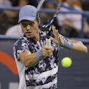 Tomas Berdych, of the Czech Republic, returns the ball to Vasek Pospisil, of Canada, at the Citi Open tennis tournament, Thursday, July 31, 2014, in Washington. (AP Photo/Luis M. Alvarez)