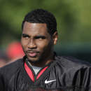 FILE - In this Aug. 9, 2014, file photo, Ohio State quarterback Braxton Miller watches teammates warm up during an NCAA college football practice in Columbus, Ohio. Ohio State's compliance office is investigating whether quarterback Braxton Miller broke any NCAA rules when he posed for a picture on social media with health-care and nutritional products. Miller was pictured on Instagram on Tuesday night, March 24, 2015, with products from AdvoCare. Miller is a graduate student who started three seasons for the Buckeyes but missed all of the Buckeyes' championship season last year after shoulder surgery. (AP Photo/Jay LaPrete, File)