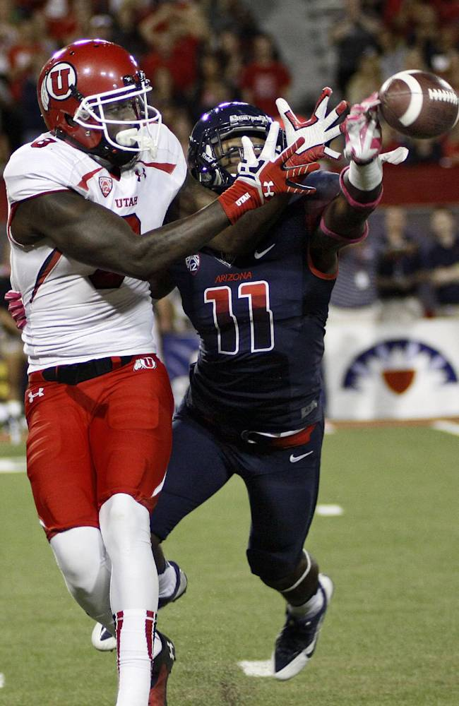 Arizona's William Parks (11) reaches and blocks the pass to Utah's Anthony Denham (8) in the second half of an NCAA college football game, Saturday, Oct. 19, 2013 in Tucson, Ariz.  Arizona won 35 - 24