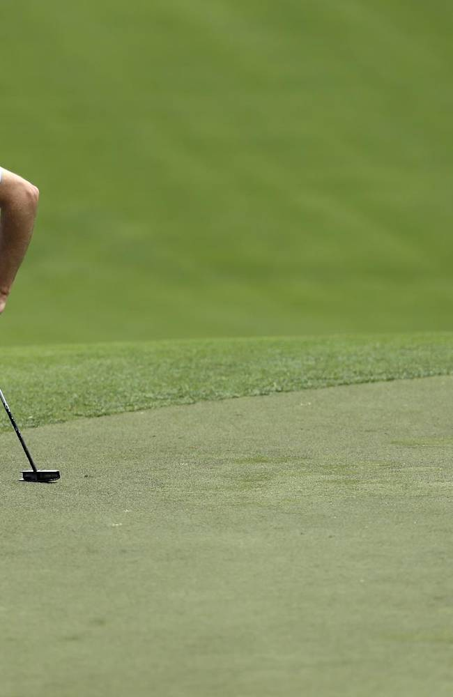 Zach Johnson lines up a putt on the second green during the first round of the Wells Fargo Championship golf tournament in Charlotte, N.C., Thursday, May 1, 2014