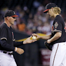 Arizona Diamondbacks manager Kirk Gibson, left, takes the ball from Bronson Arroyo after Arroyo gave us his eighth run against the New York Mets during the fourth inning of a baseball game on Tuesday, April 15, 2014, in Phoenix The Associated Press