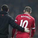 In this Nov. 29, 2014 photo, Manchester United's Wayne Rooney walks from the pitch after being injured during the English Premier League soccer match between Manchester United and Hull City at Old Trafford Stadium, Manchester, England. The Manchester Uni