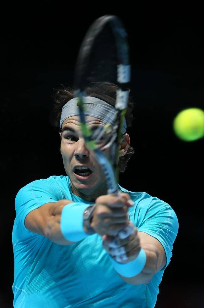 Rafael Nadal of Spain plays a return to Roger Federer of Switzerland during their ATP world Tour Finals tennis semifinal match at the O2 Arena on London, Sunday, Nov. 10, 2013