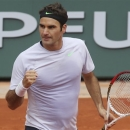 Switzerland's Roger Federer clenches his fist after scoring a point against Julien Benneteau of France  in their third round match at the French Open tennis tournament, at Roland Garros stadium in Paris, Friday, May 31, 2013. (AP Photo/Michel Euler)