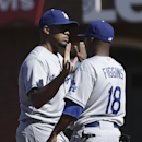 Los Angeles Dodgers pitcher Kenley Jansen, left, celebrates with teammate Chone Figgins after they defeated the San Francisco Giants in a baseball game in San Francisco, Thursday, April 17, 2014. The Dodgers won 2-1 The Associated Press