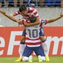 Landon Donovan of the U.S. is embraced by teammate Joe Corona after scoring a goal during the second half of their CONCACAF Gold Cup quarter-final soccer match against El Salvador in Baltimore, Maryland July 21, 2013. REUTERS/Doug Kapustin